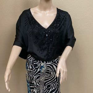 Bebe top with sequins. Size M